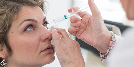 Doctor giving woman ophthalmology treatment